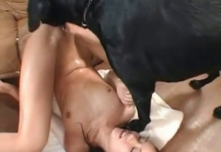 Tight snatch gets nicely licked by the dog